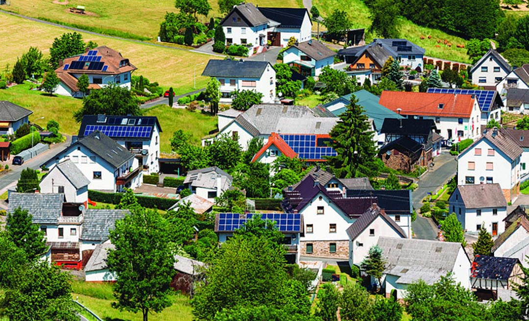 aerial view of houses with rooftop solar panels